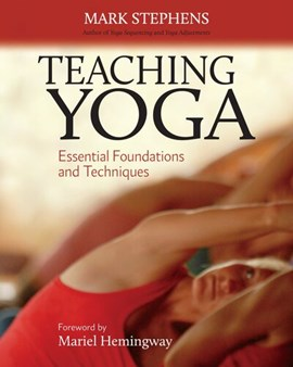 Teaching yoga by Mark Stephens